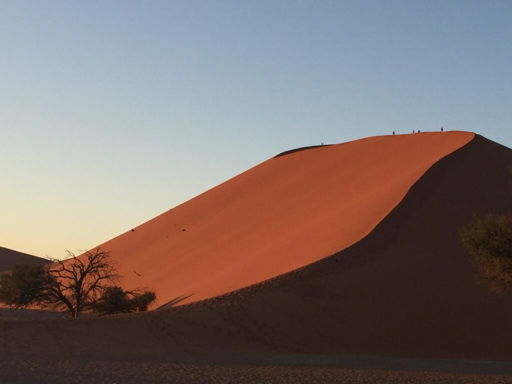 Dune 45 at sunrise with the side glowing red