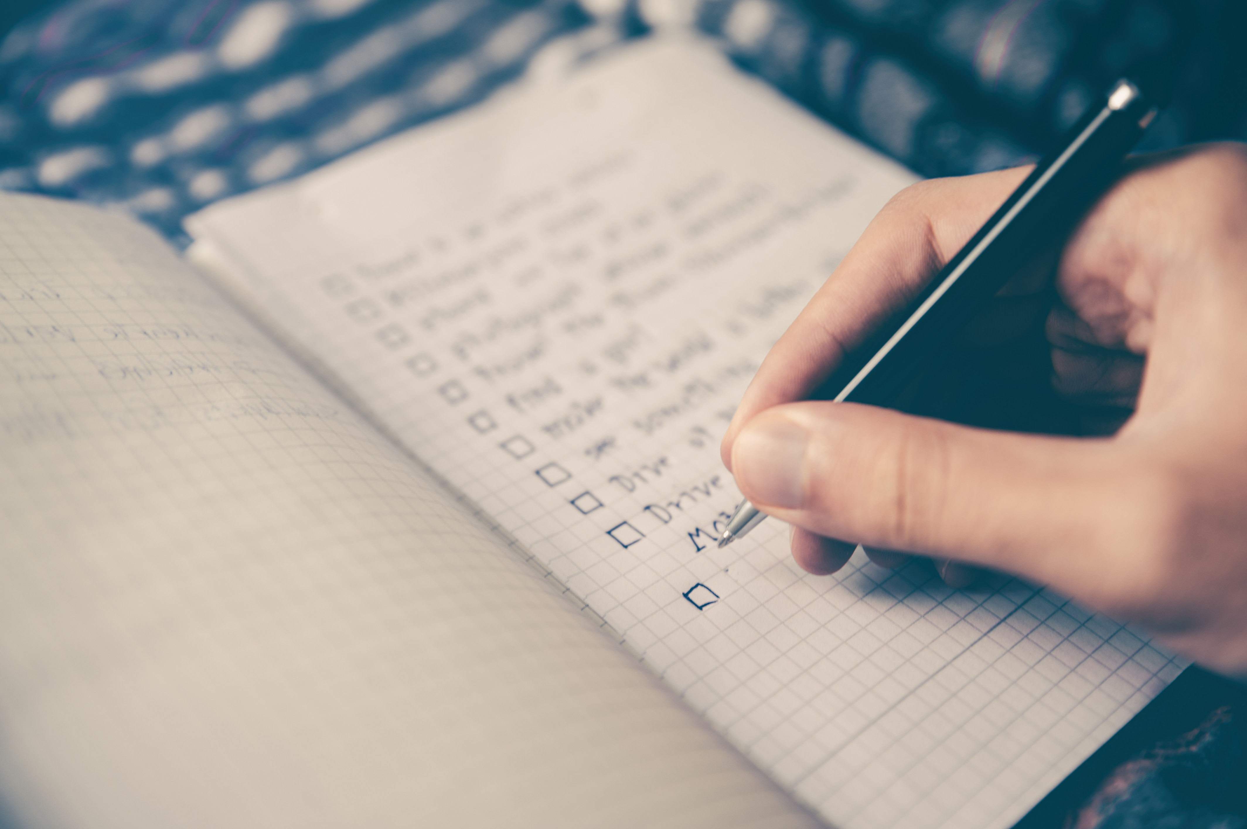 Photo by Glenn Carstens-Peters on Unsplash- Book with a to-do list written in it