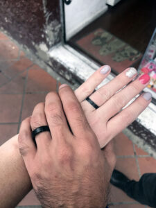 Our two hands with matching black rings on our fingers